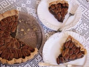 mexican chocolate pecan pie with two slices cut out on plates