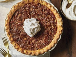 whole texas pecan pie with whipped cream