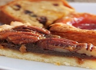 pecan pie slice in front of other pastries