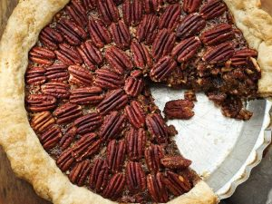 pecan pie with slice cut out