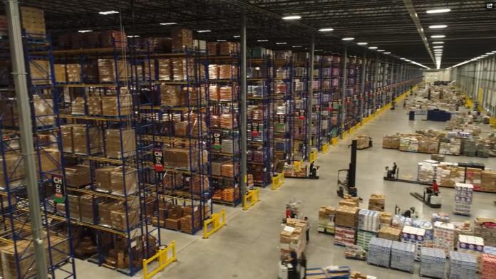 inside a fully stocked H-E-B warehouse