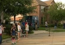 neighbors standing in driveway standing apart