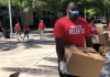 houston rockets employees handing out free groceries and meals