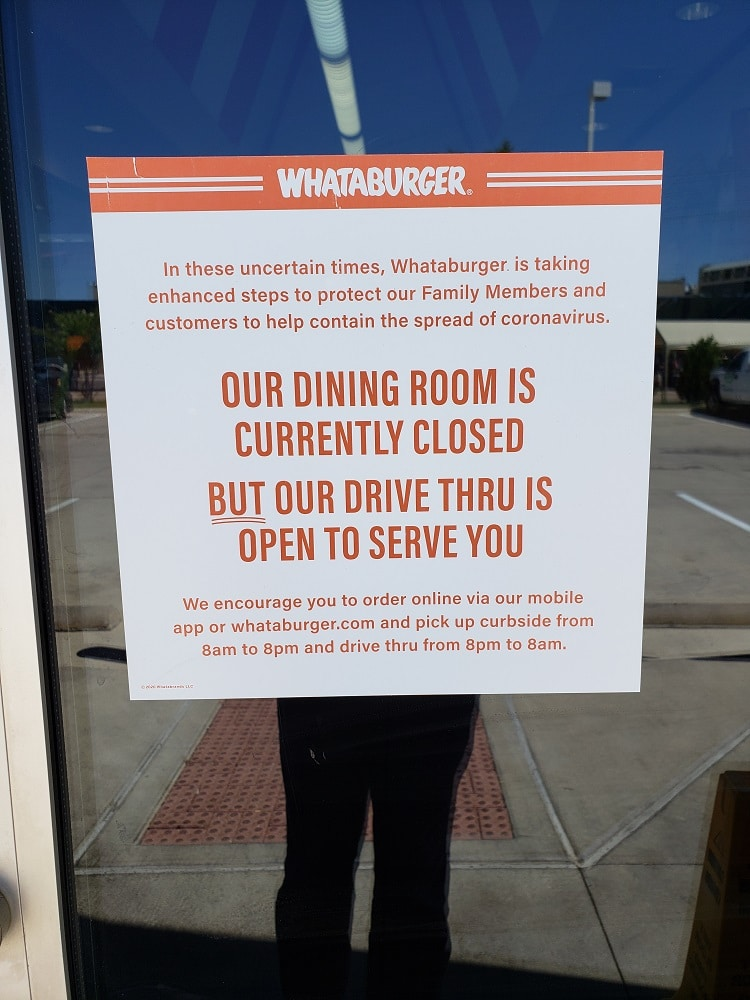 whataburger dining room closed due to pandemic sign on door