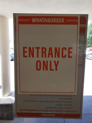 entrance only sign on whataburger door