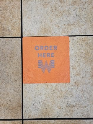 whataburger order here floor sign