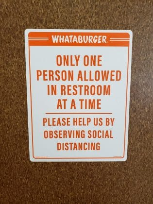 only one person in restroom sign at a whataburger