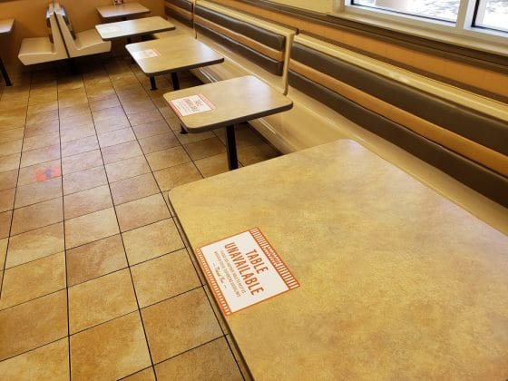 tables at a whataburger closed to access