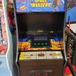 space invaders arcade game at a barber shop in dallas
