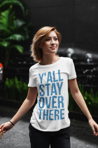 woman wearing y'all stay over there t-shirt at night