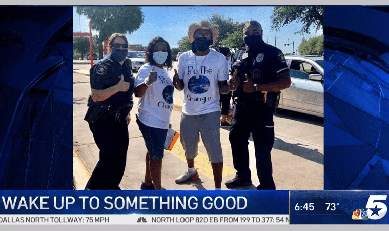 volunteers with carrollton tx police officers at a $10,000 gasoline give away in 2020