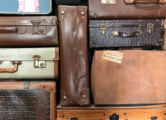 stack of used suitcases