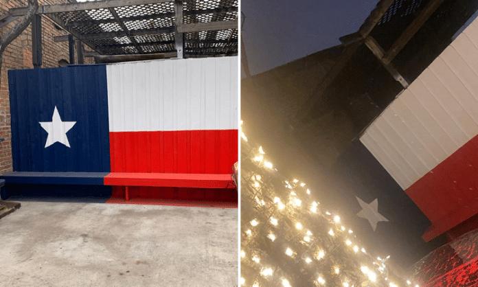 elm street saloon deep ellum dallas texas flag bench