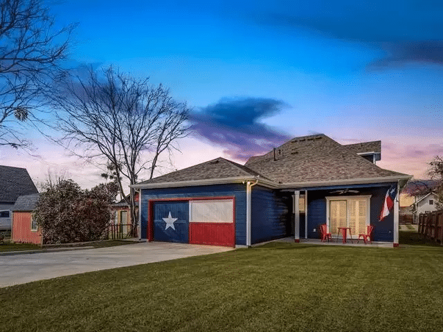 texas themed house with flag painted on garage