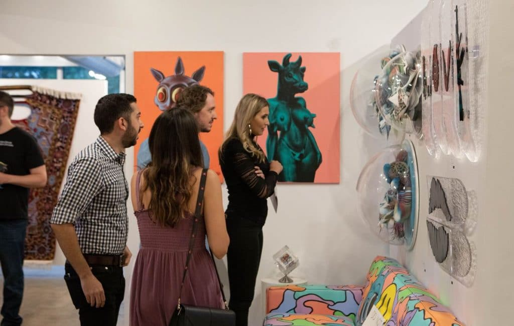 attendees at soco modern art gallery grand opening event in austin, tx