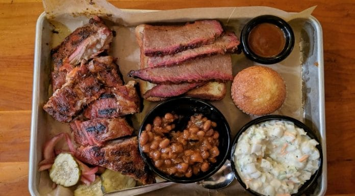 BBQ barbeque plate on a tray on a wooden table
