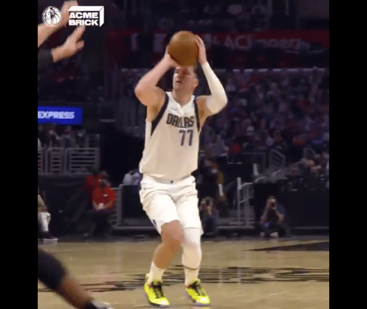 Dallas Mavericks Luka Doncic holding a basketball in the NBA playoffs Game 1