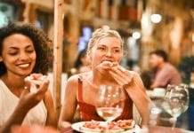 women sitting outside eating on a patio