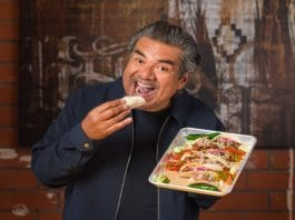 George Lopez eating one of his badass tacos