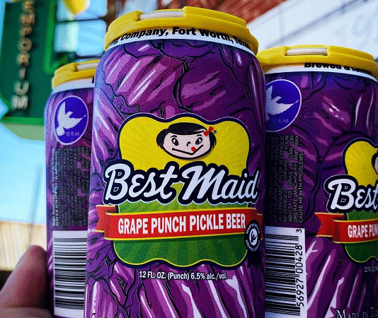 martin house grape punch pickle beer cans in a hand