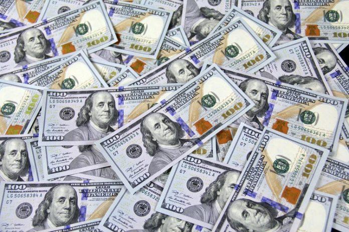 pile of $100 bills money laying around