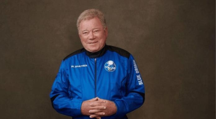 William Shatner dressed in a blue astronaut suit